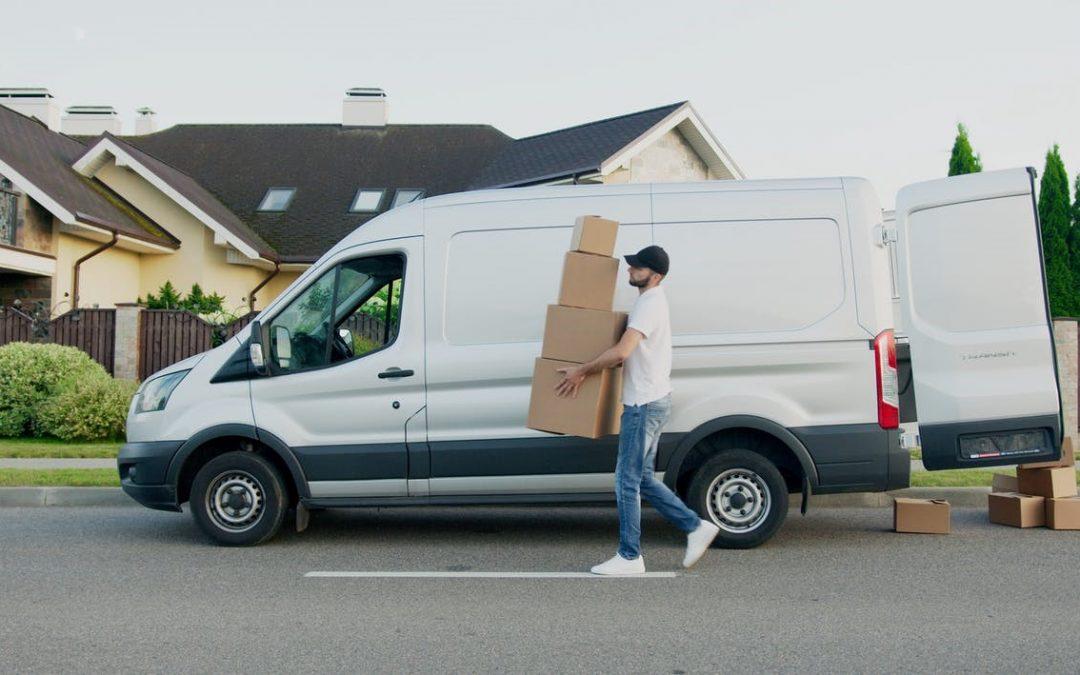 A deliveryman delivering courier boxes.